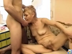 Shorthaired oldie gets her pink flower stretched wide open by her sonny