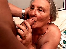 Dirty old granny sucks off two guys at once
